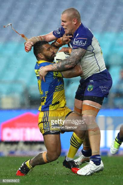 Manu Ma'u of the Eels is tackled by David Klemmer of the Bulldogs during the round 22 NRL match between the Canterbury Bulldogs and the Parramatta...