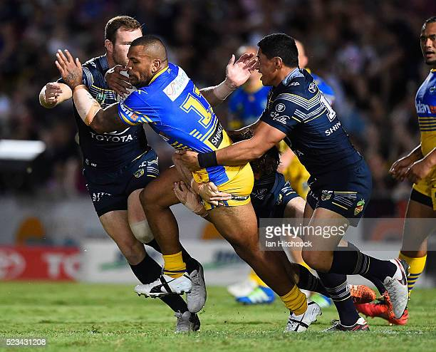 Manu Ma'u of the Eels is tackled by Jason Taumalolo and Gavin Cooper of the Cowboys during the round eight NRL match between the North Queensland...