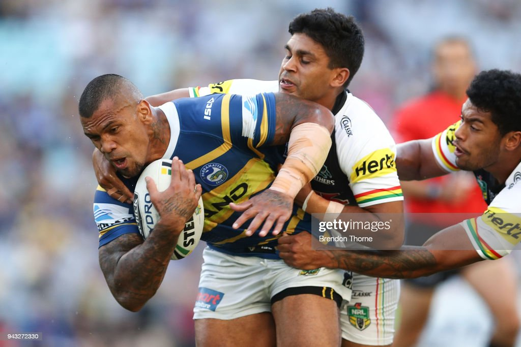 Manu Ma'u of the Eels is tackled by the Panthers defence during the round five NRL match between the Parramatta Eels and the Penrith Panthers at ANZ Stadium on April 8, 2018 in Sydney, Australia.