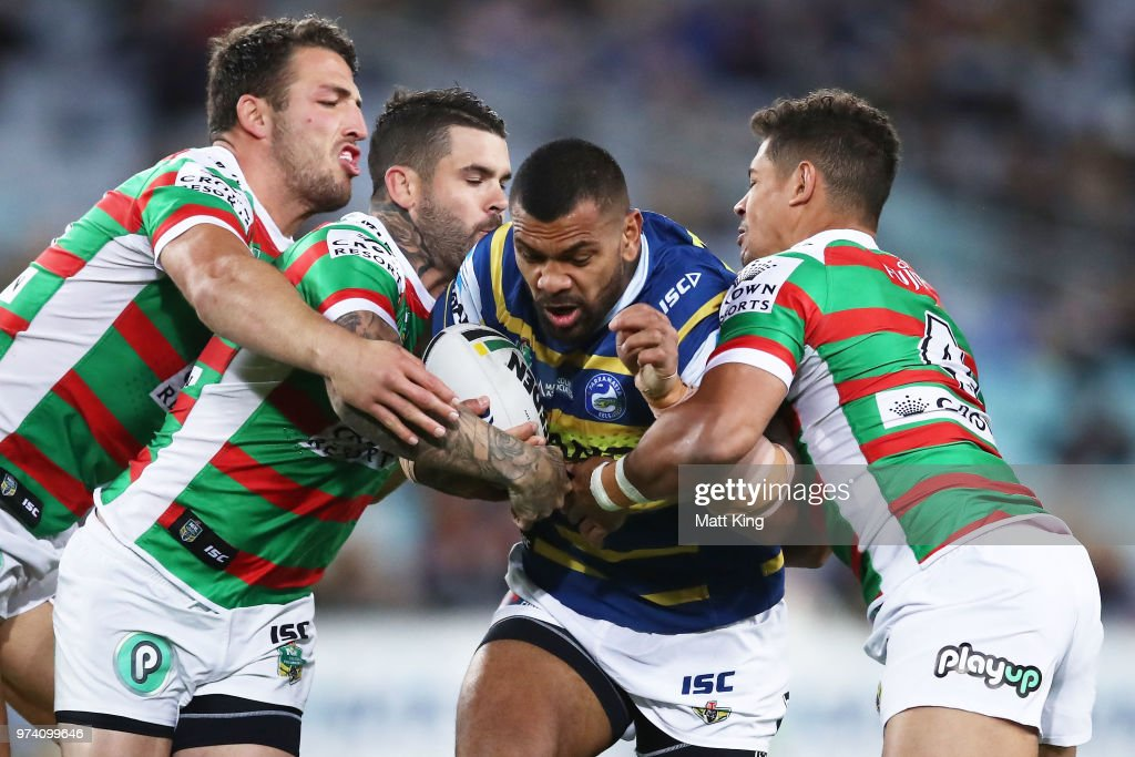 Manu Ma'u of the Eels is tackled during the round 15 NRL match between the Parramatta Eels and the South Sydney Rabbitohs at ANZ Stadium on June 14, 2018 in Sydney, Australia.