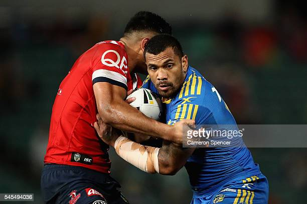 Manu Ma'u of the Eels is tackled during the round 18 NRL match between the Parramatta Eels and the Sydney Roosters at Pirtek Stadium on July 8 2016...