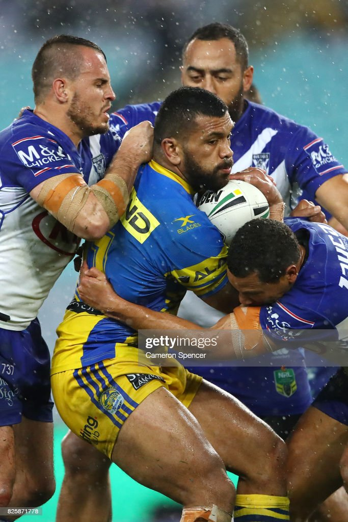 Manu Ma'u of the Eels is tackled during the round 22 NRL match between the Canterbury Bulldogs and the Parramatta Eels at ANZ Stadium on August 3, 2017 in Sydney, Australia.