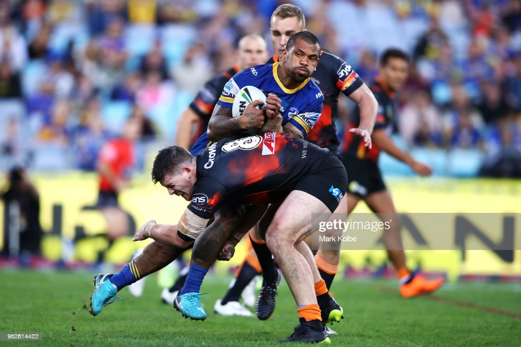 Manu Ma'u of the Eels is tackled during the round Eight NRL match between the Parramatta Eels and the Wests Tigers at ANZ Stadium on April 29, 2018 in Sydney, Australia.