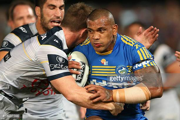 Manu Ma'u of the Eels is tackled during the round two NRL match between the Parramatta Eels and the North Queensland Cowboys at Pirtek Stadium on...