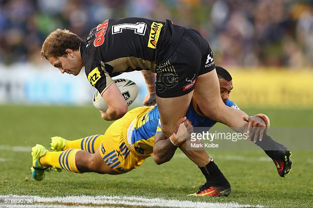 Manu Ma'u of the Eels tackles Matt Moylan of the Panthers during the round 19 NRL match between the Penrith Panthers and the Parramatta Eels at...