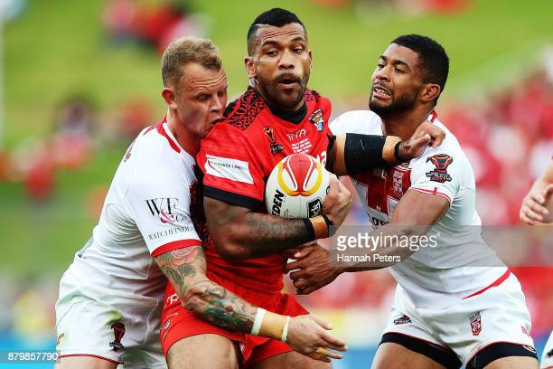 Manu Ma'u of Tonga charges forward during the 2017 Rugby League World Cup Semi Final match between Tonga and England at Mt Smart Stadium on November...
