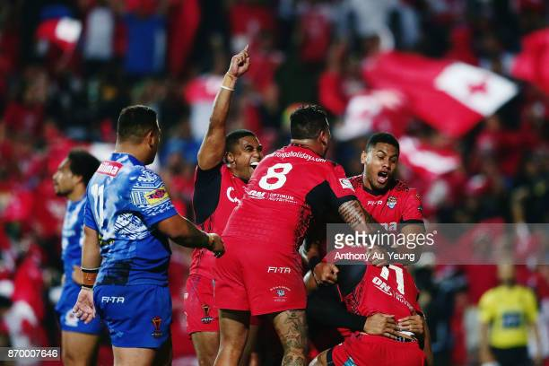 Manu Ma'u of Tonga is mobbed by teammates after scoring a try during the 2017 Rugby League World Cup match between Samoa and Tonga at Waikato Stadium...