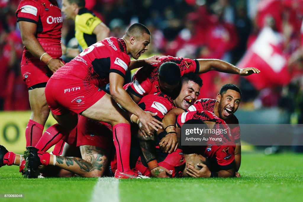 Manu Ma'u of Tonga is mobbed by teammates after scoring a try during the 2017 Rugby League World Cup match between Samoa and Tonga at Waikato Stadium on November 4, 2017 in Hamilton, New Zealand.