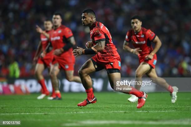 Manu Ma'u of Tonga is tackled during the 2017 Rugby League World Cup match between Samoa and Tonga at Waikato Stadium on November 4 2017 in Hamilton...