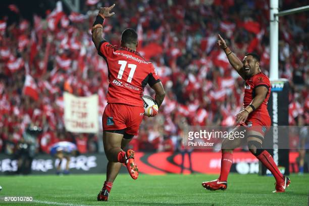 Manu Ma'u of Tonga runs in the winning try as Stone Katoa of Tonga celebrates during the 2017 Rugby League World Cup match between Samoa and Tonga at...