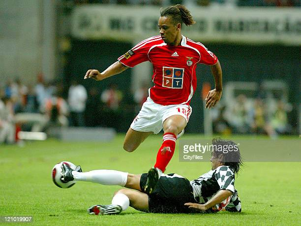 Manu of Benfica and Mario Silva of Boavista Benfica suffered one heavy defeat in its start of the Portuguese Soccer League losing for 30 against...