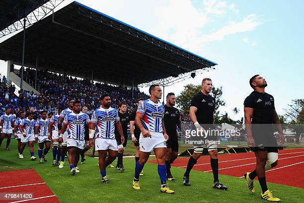 Manu Samoa and the New Zealand All Blacks walk out for the International Test match between Samoa and the New Zealand All Blacks at Apia Stadium on...