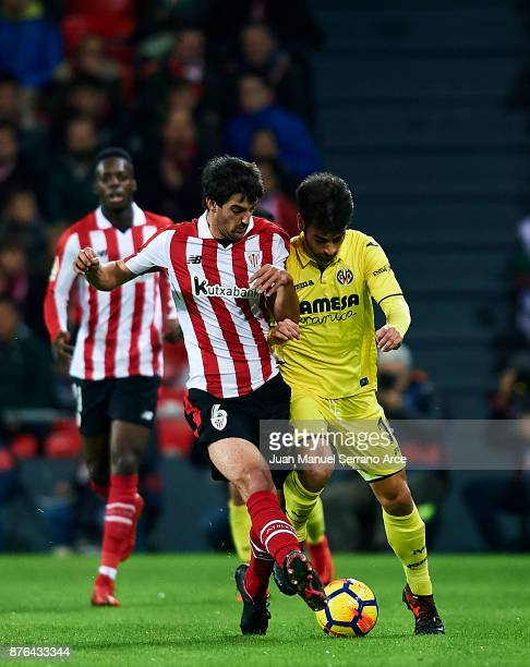 Manu Trigueros of Villarreal CF competes for the ball with Mikel San Jose of Athletic Club during the La Liga match between Athletic Club Bilbao and...
