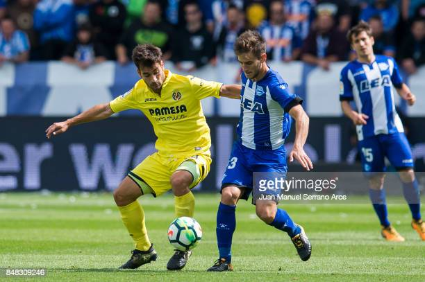 Manu Trigueros of Villarreal CF duels for the ball with Alvaro Medran of Deportivo Alaves during the La Liga match between Deportivo Alaves and...