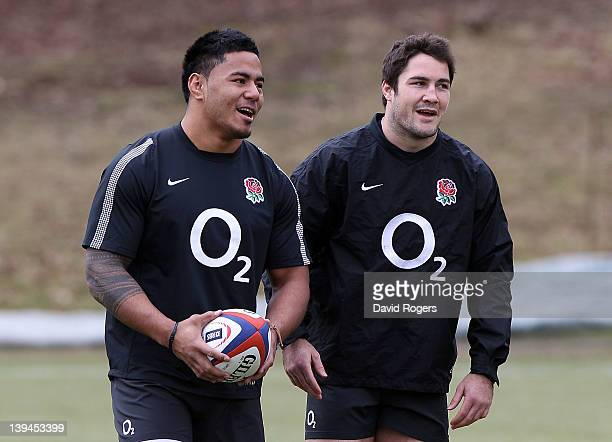 Manu Tuilagi and Brad Barritt look on during the England training session held at Pennyhill Park on February 21 2012 in Bagshot England