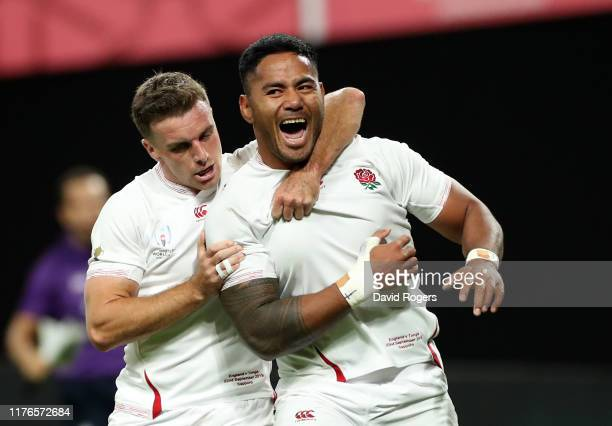 Manu Tuilagi celebrates with team mate George Ford after scoring his second try during the Rugby World Cup 2019 Group C game between England and...