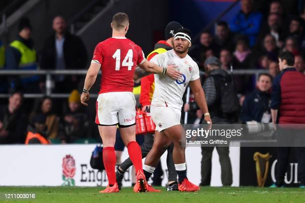 Manu Tuilagi of England apologises to George North of Wales for a bad tackle which resulted in a red card for Manu Tuilagi during the 2020 Guinness...