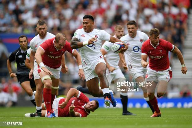 Manu Tuilagi of England breaks through during the 2019 Quilter International match between England and Wales at Twickenham Stadium on August 11, 2019...