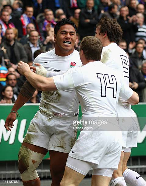 Manu Tuilagi of England celebrates his opening try with team mates during the RBS 6 Nations match between France and England at Stade de France on...