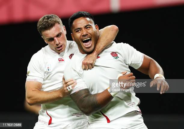 Manu Tuilagi of England celebrates scoring his side's second try with his team mate George Ford during the Rugby World Cup 2019 Group C game between...