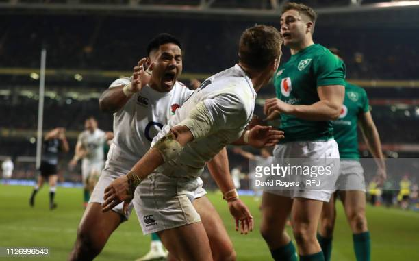 DUBLIN IRELAND FEBRUARY 02 Manu Tuilagi of England celebrates with Henry Slade after Slade scores his first try during the Guinness Six Nations match...