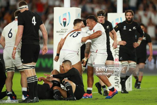 Manu Tuilagi of England celebrates with Mako Vunipola after scoring a try during the Rugby World Cup 2019 SemiFinal match between England and New...