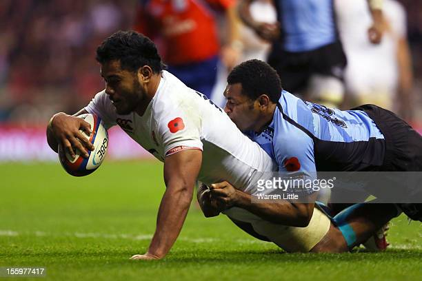 Manu Tuilagi of England crashes over the tryline to score his team's seventh try during the QBE international match between England and Fiji at...