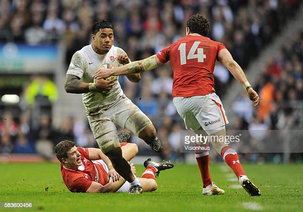 Manu Tuilagi of England escapes from Scott Williams and is tackled by Alex Cuthbert of Wales during the RBS Six Nations match between England and...