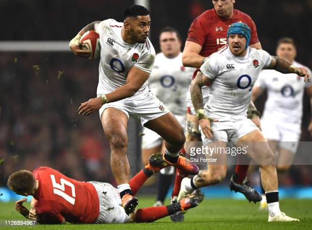 Manu Tuilagi of England escapes the tackle of Liam Williams of Wales during the Guinness Six Nations match between Wales and England at Principality...