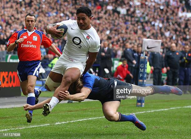 Manu Tuilagi of England evades a tackle by Aurelien Rougerie of France to score the opening try during the RBS 6 Nations match between France and...