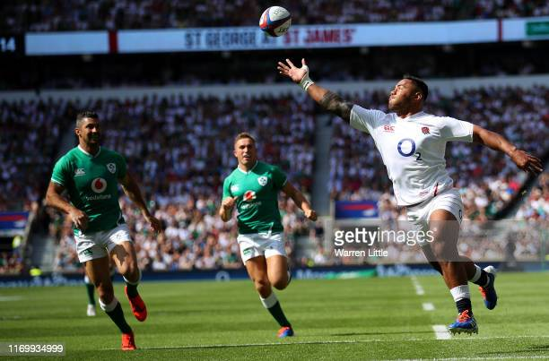 Manu Tuilagi of England fails to prevent Jordan Lamour of Ireland scoring a try during the Quilter International match between England and Ireland at...
