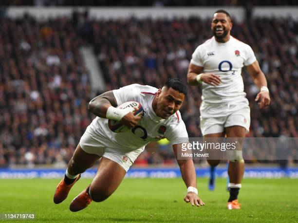 Manu Tuilagi of England goes over to score his team's third try during the Guinness Six Nations match between England and Italy at Twickenham Stadium...