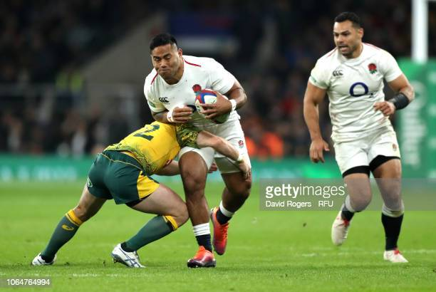 Manu Tuilagi of England is tackled by Bernard Foley of Australia during the Quilter International match between England and Australia at Twickenham...