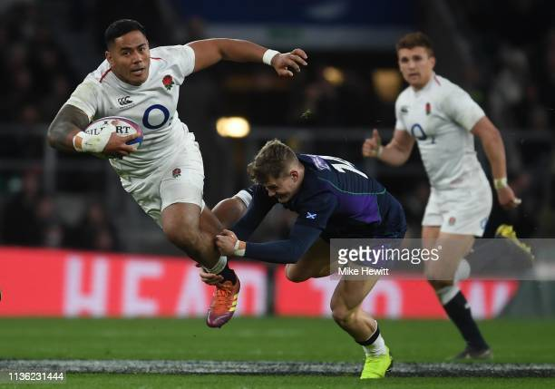 Manu Tuilagi of England is tackled by Darcy Graham of Scotland during the Six Nations match between England and Scotland at Twickenham Stadium on...