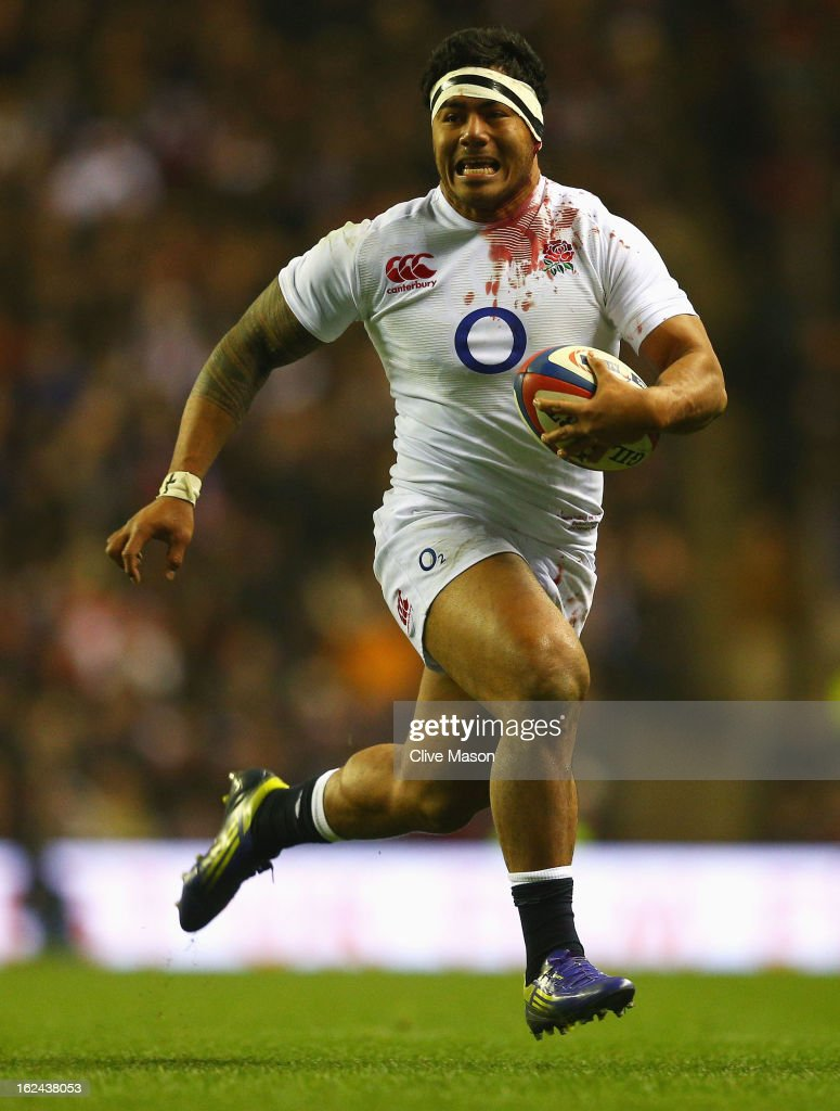 Manu Tuilagi of England runs through to score a try during the RBS Six Nations match between England and France at Twickenham Stadium on February 23, 2013 in London, England.