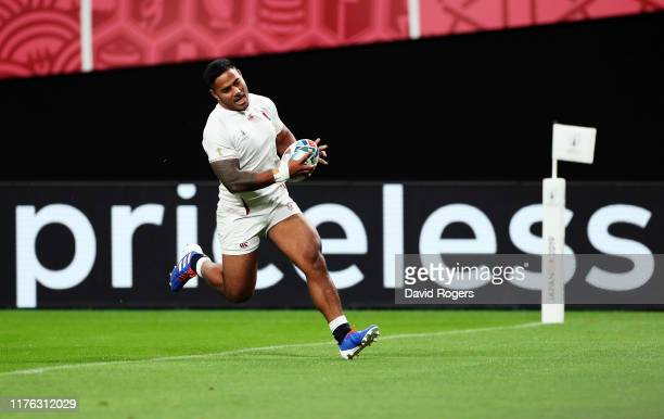 Manu Tuilagi of England runs with the ball to score his side's second try during the Rugby World Cup 2019 Group C game between England and Tonga at...