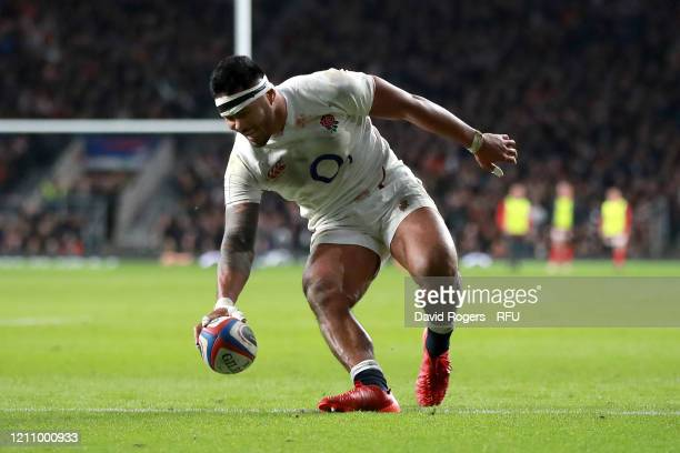 Manu Tuilagi of England touches down to score his sides third try during the 2020 Guinness Six Nations match between England and Wales at Twickenham...