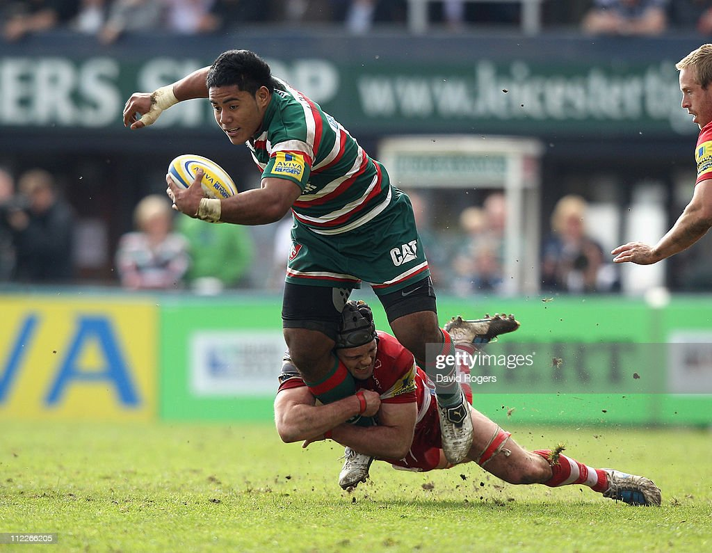 Manu Tuilagi of Leicester is tackled by Andy Hazell during the Aviva Premiership match between Leicester Tigers and Gloucester at Welford Road on April 16, 2011 in Leicester, England.