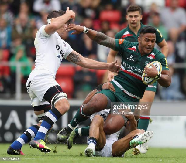 Leicester Centre Manu Tuilagi Is Tackled: Joseph Louw Stock Photos And Pictures