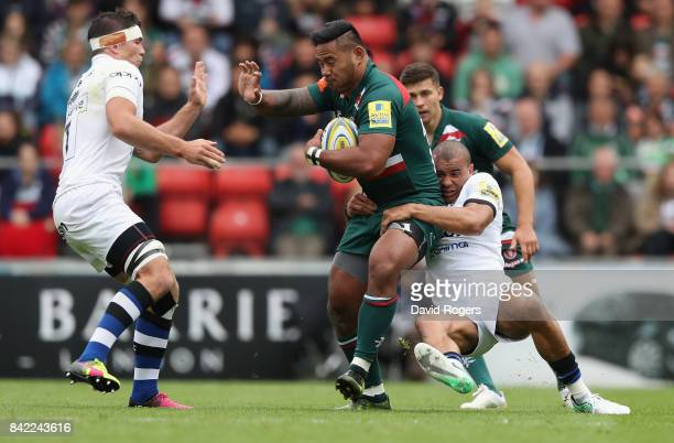 Manu Tuilagi of Leicester is tackled by Jonathan Joseph and Francois Louw during the Aviva Premiership match between Leicester Tigers and Bath Rugby...