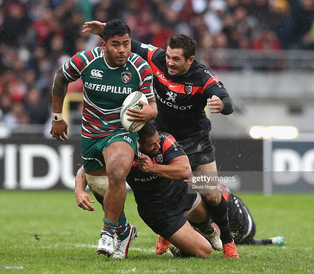 Manu Tuilagi of Leicester moves away from Luke McAlister and Florian Fritz (R) during the Heineken Cup match between Toulouse and Leicester Tigers at Le Stadium on October 14, 2012 in Toulouse, France.