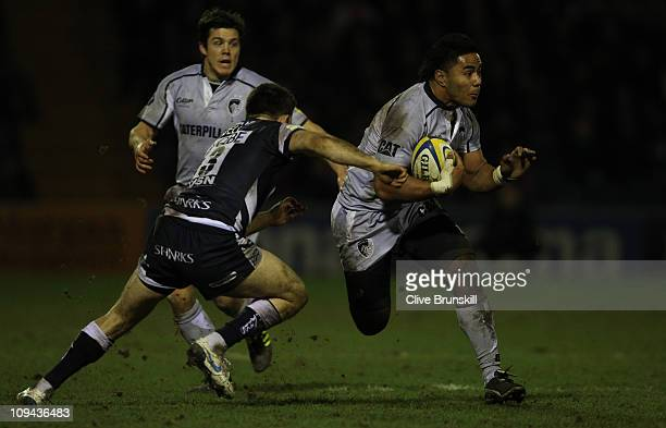 Manu Tuilagi of Leicester Tigers moves forward with the ball past Chris Bell of Sale Sharks during the AVIVA Premiership match between Sale Sharks...