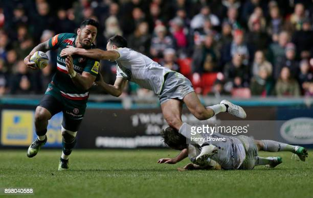 Manu Tuilagi of Leicester Tigers tackled by Alex Lozowski of Saracens during the Aviva Premiership match between Leicester Tigers and Saracens at...