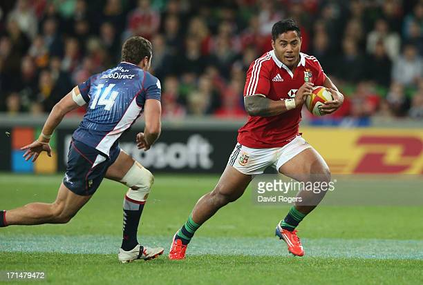Manu Tuilagi of the Lions takes on Tom English during the International Tour Match between the Melbourne Rebels and the British Irish Lions at AAMI...