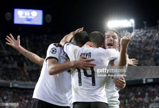 Manu Vallejo Jose Luis Gaya and Maximiliano Gomez of Valencia celebrate their team's second goal which was an own goal scored by Adama Soumaoro of...