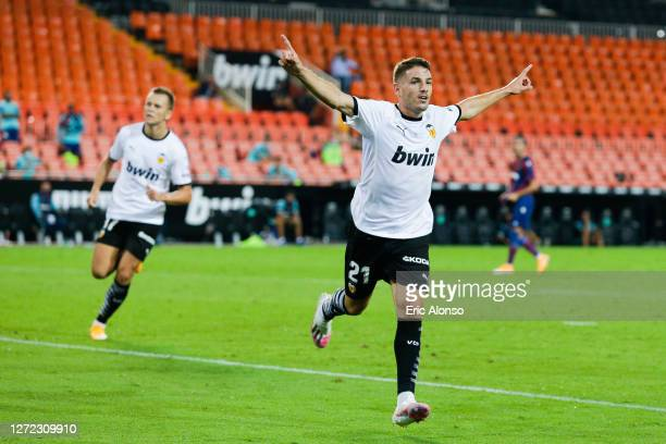 Manu Vallejo of Valencia CF celebrates after scoring his team's fourth goal during the La Liga match between Valencia CF and Levante UD at Estadio...