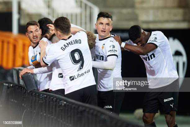 Manu Vallejo of Valencia CF celebrates with teammates after scoring the opening goal during the La Liga Santander match between Valencia CF and RC...