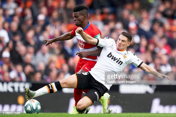Manu Vallejo of Valencia CF competes for the ball with Azeez of Granada CF during the La Liga match between Valencia CF and Granada CF at Estadio...