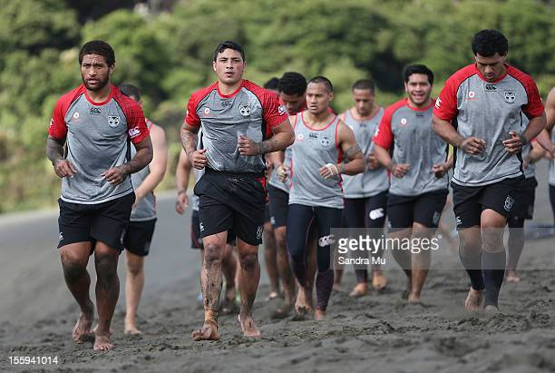 Manu Vatuvei and Kevin Locke and the team train on the sand dunes during the New Zealand Warriors NRL training session at Bethells Beach on November...