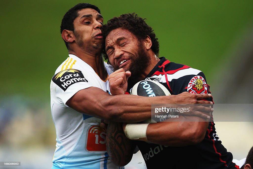 Manu Vatuvei of the Warriors crashes into Albert Kelly of the Titans during the round eight NRL match between the New Zealand Warriors and the Gold Coast Titans at Mt Smart Stadium on May 5, 2013 in Auckland, New Zealand.